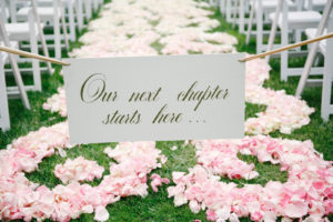 Our next chapter starts here, ceremony sign for the aisle