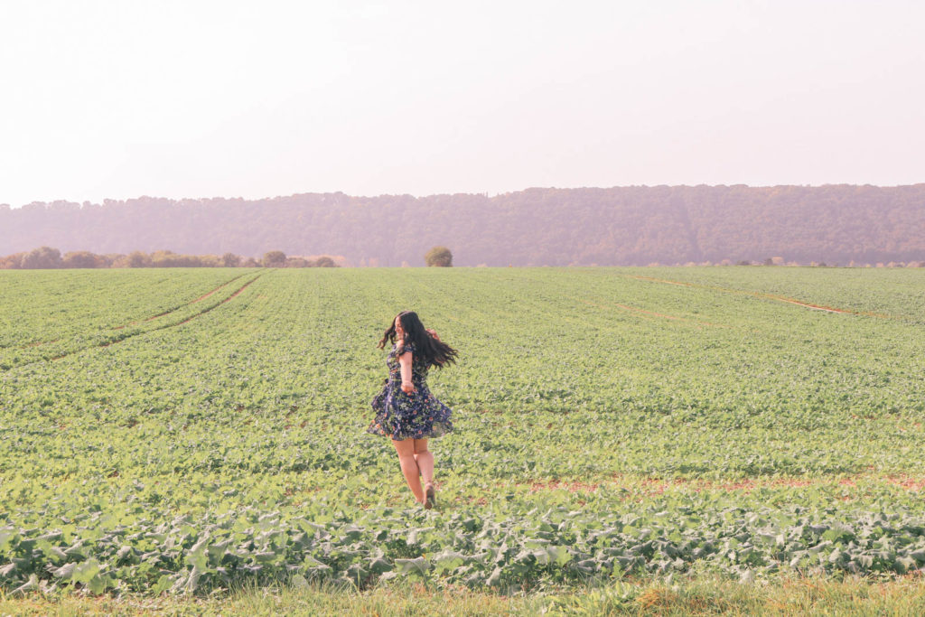 Self care checklist when you're feeling stressed and overwhelmed. Girl dancing carefree in a field in the countryside