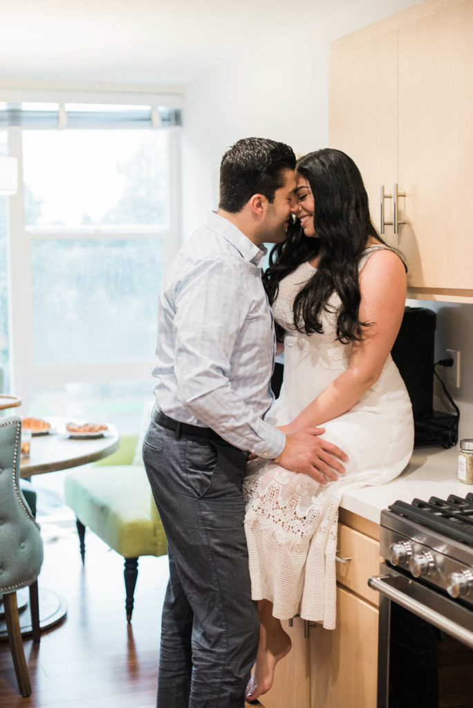 Stay at home date night ideas. Dancing in the kitchen while making dinner together as a couple. Perfect for a budget friendly and fun date night at home
