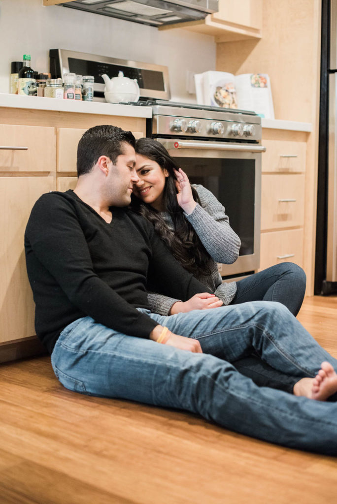 At home date night ideas. Cooking dinner together and cuddling on the kitchen floor.