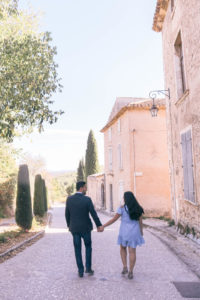 Couple walking in Oppede, Provence