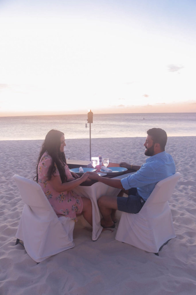 Romantic beach dinner for Aruba honeymoon