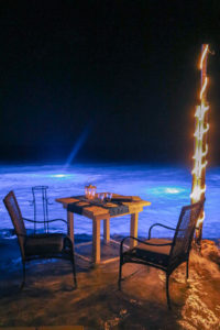 Dinner with feet in the water, romantic Aruba honeymoon