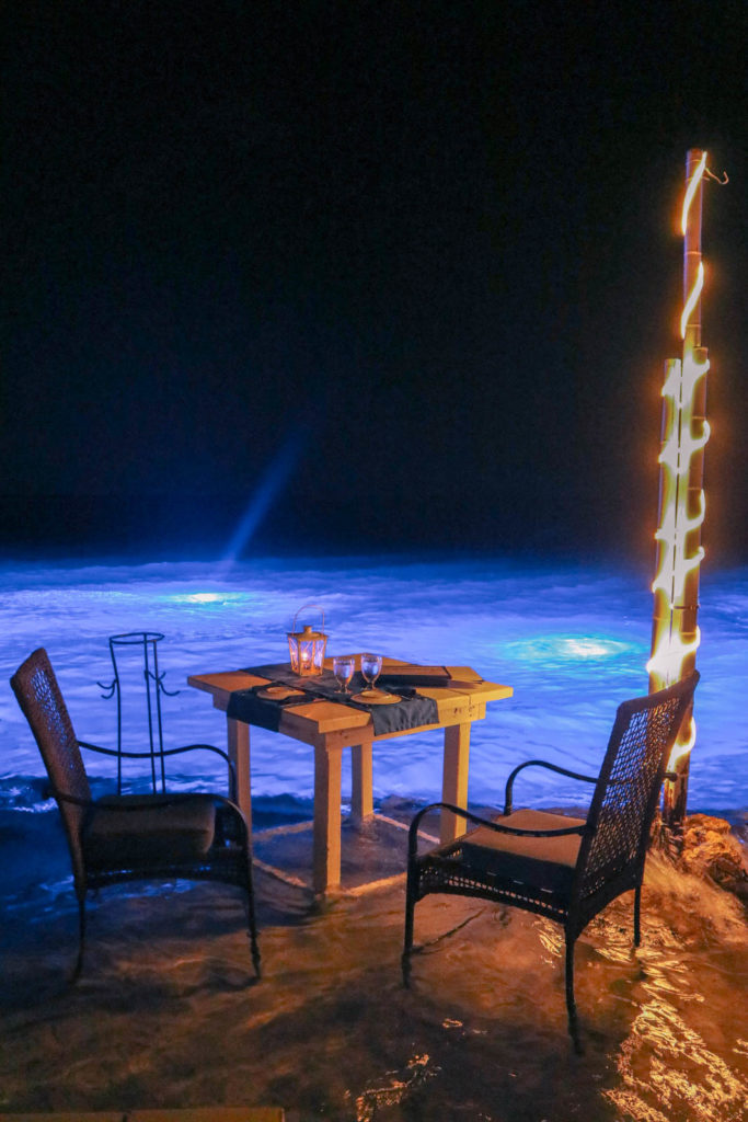 Dinner with feet in the water, romantic Aruba honeymoon