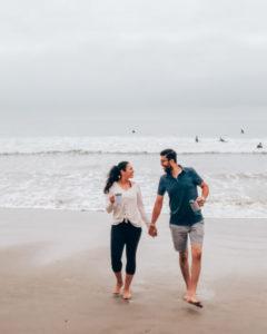 Lena and Bassam walking on the beach