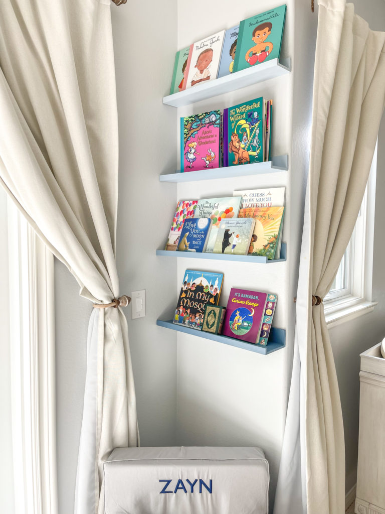 image of ombre blue book wall in shooting star nursery