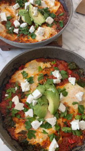 photo of two pans containing vegetable shakshuka